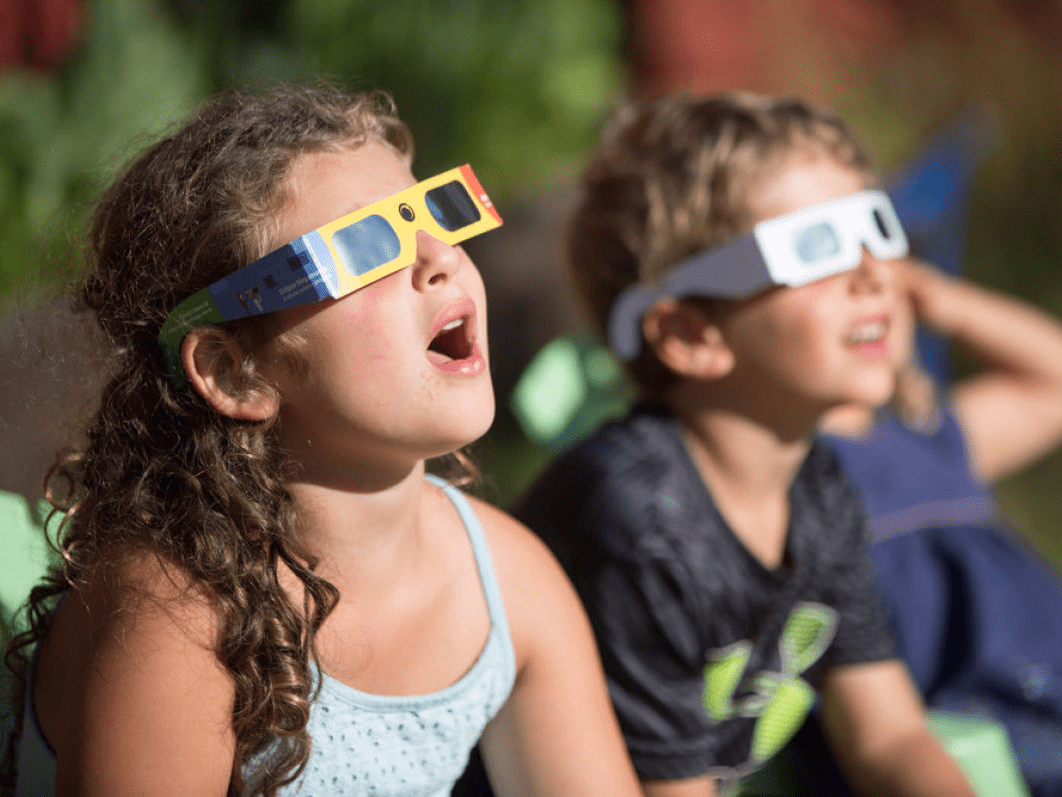 Is Giving Young Kids Special Glasses To Watch The Solar Eclipse