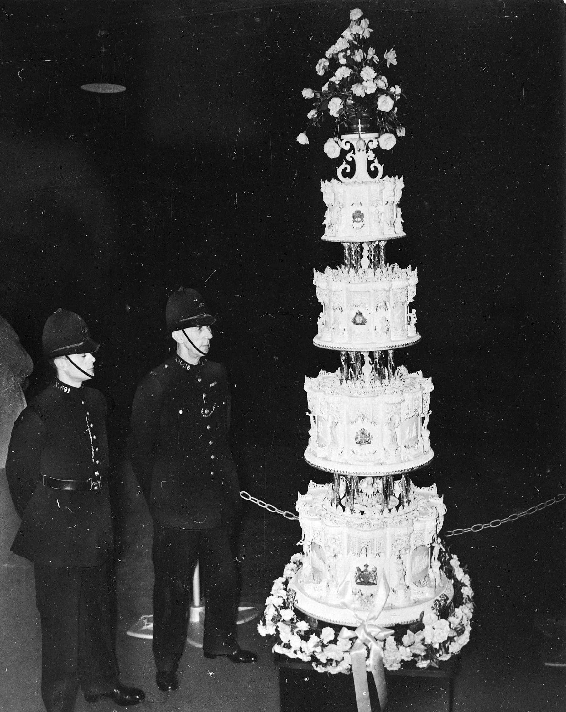 Queen Elizabeth II and Prince Phillip's wedding cake in 1947 weighed 500 pounds, stood at nine feet tall, and took two weeks to make.