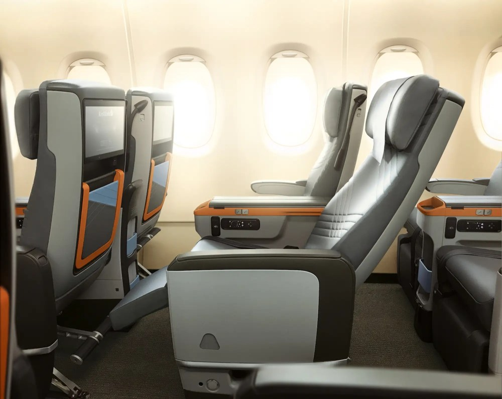 Premium economy passengers get 19.5-inch wide seats and 38 inches of seat pitch. In addition, the seats are equipped with a 13.3 inch HD screen and noise canceling headphones.