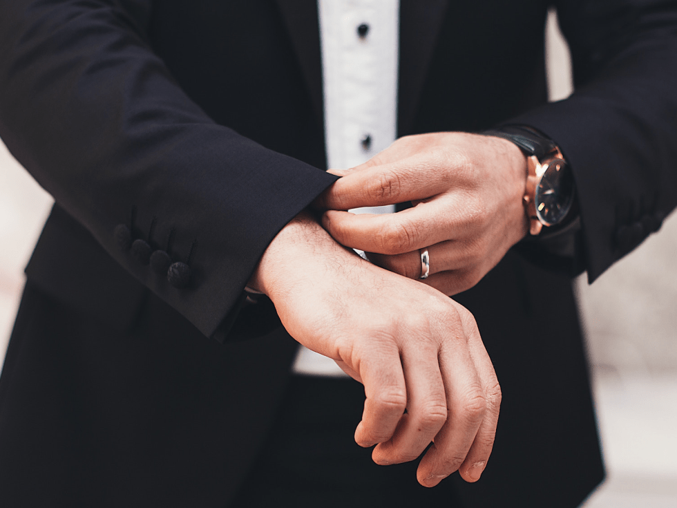 man with nice watch in suit