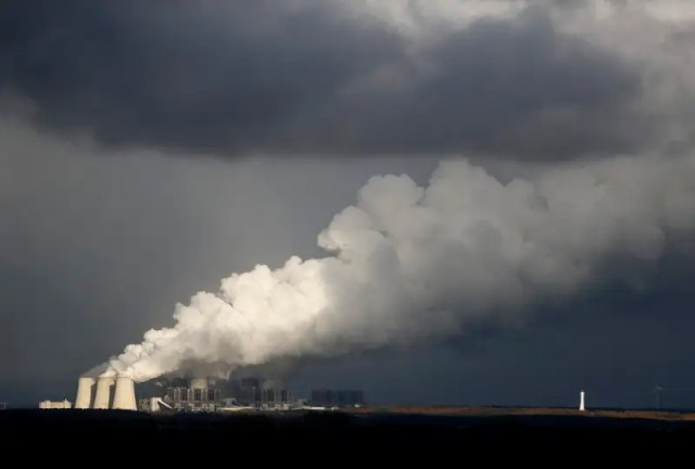 Smoke rises from the coal power plant in Jaenschwalde, Germany February 3, 2018. REUTERS/Hannibal Hanschke