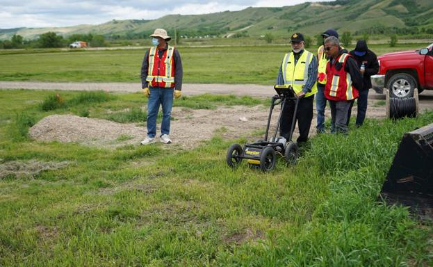Technicians probe the grounds of Marieval boarding school with georadars.
