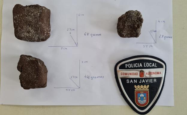 The three hashish stones found by the bather on a La Manga beach.