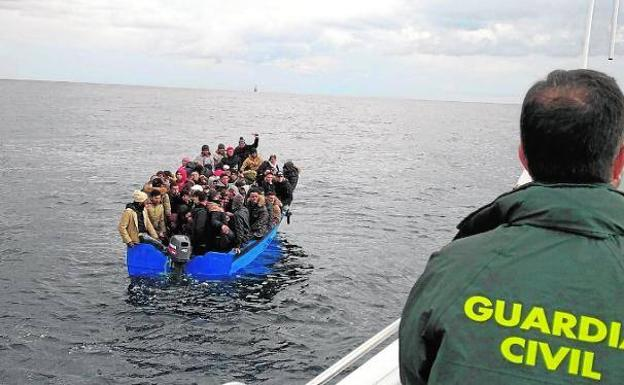 The occupants of a patera, packed with immigrants, in a file image.