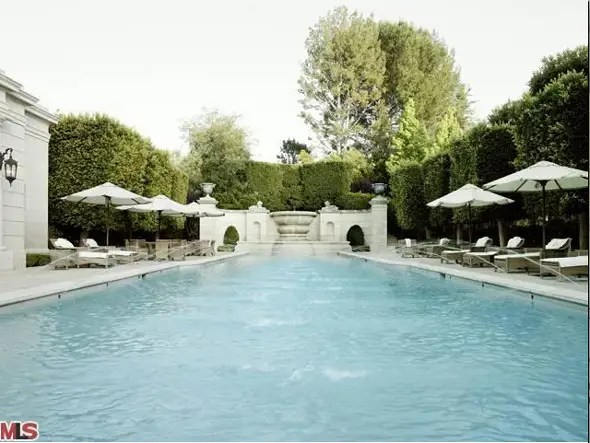 In addition to a swimming pool, the estate has two motor courts, a spa complex, and a tennis court.