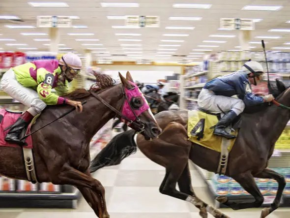 Once customers start walking through the 'racetrack' aisles, they are conditioned to walk up and down each aisles without deviating