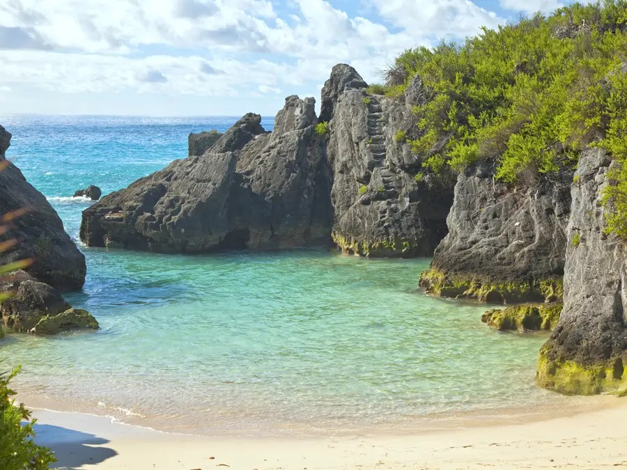 Jobson's Cove is a tiny pink-sand beach in Bermuda that's surrounding by an amazing rock formation that creates a calm wading pool.