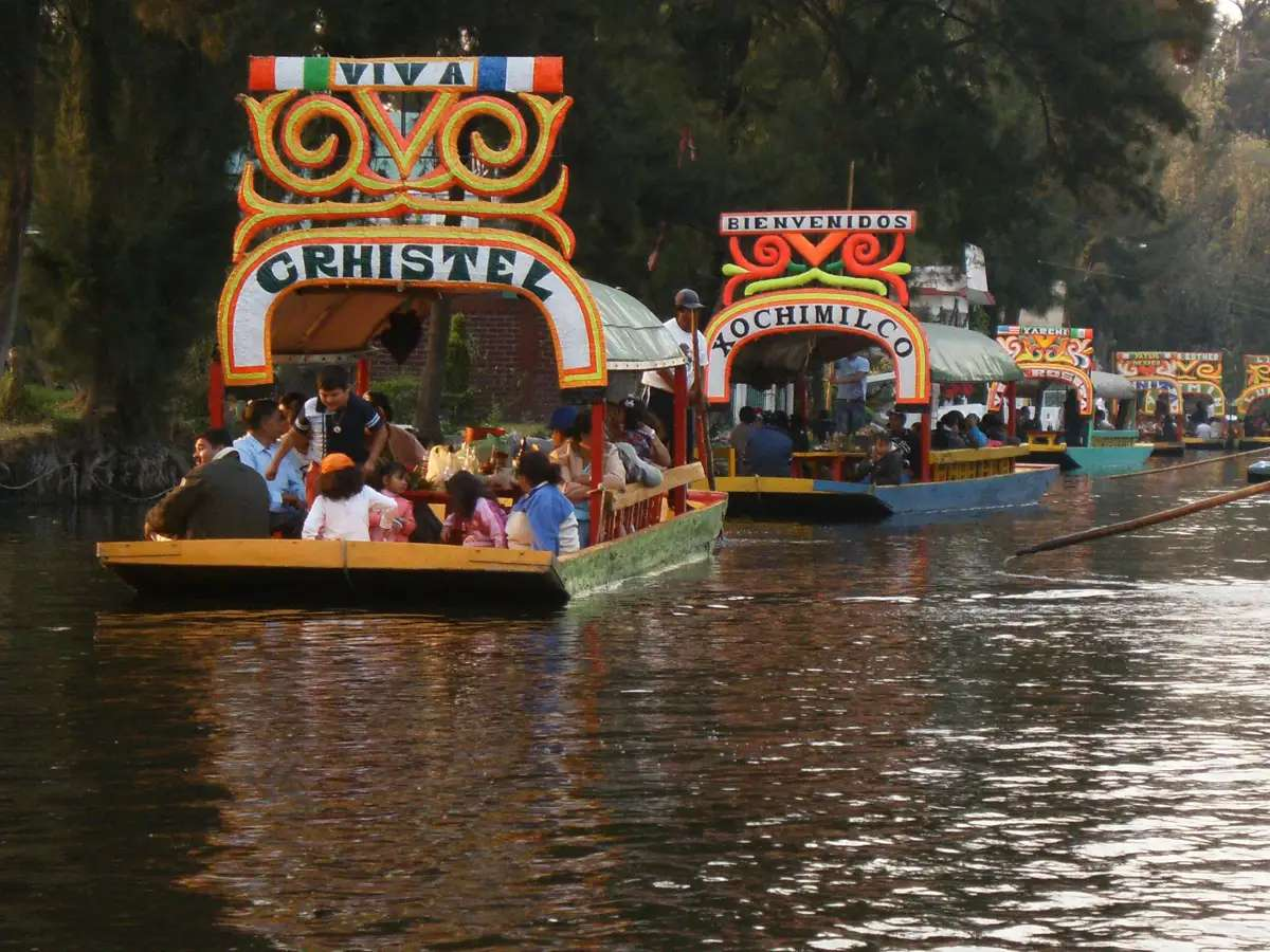 Ride the canals of Xochimilco, outside of Mexico City, in a trajinera (a brightly-painted non-motorized barge).