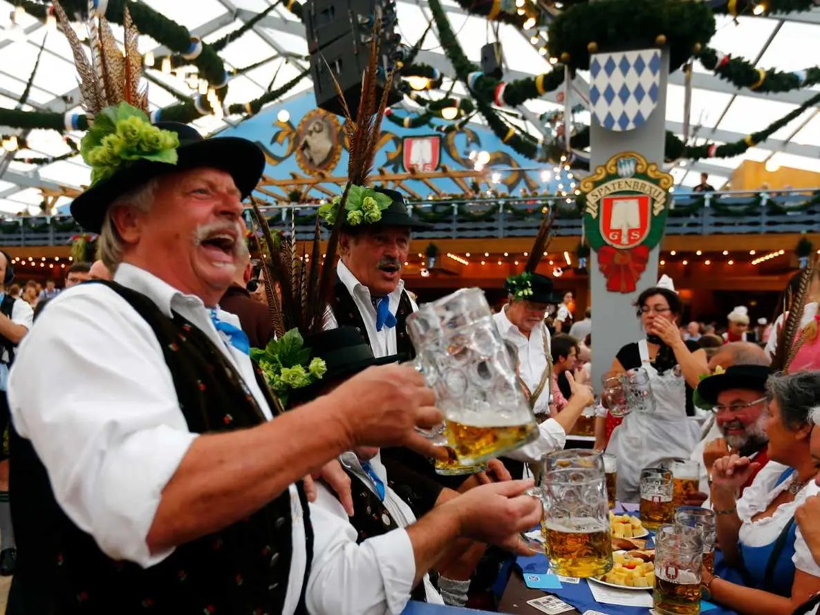 Drink a beer from a stein during Oktoberfest in Munich, Germany.