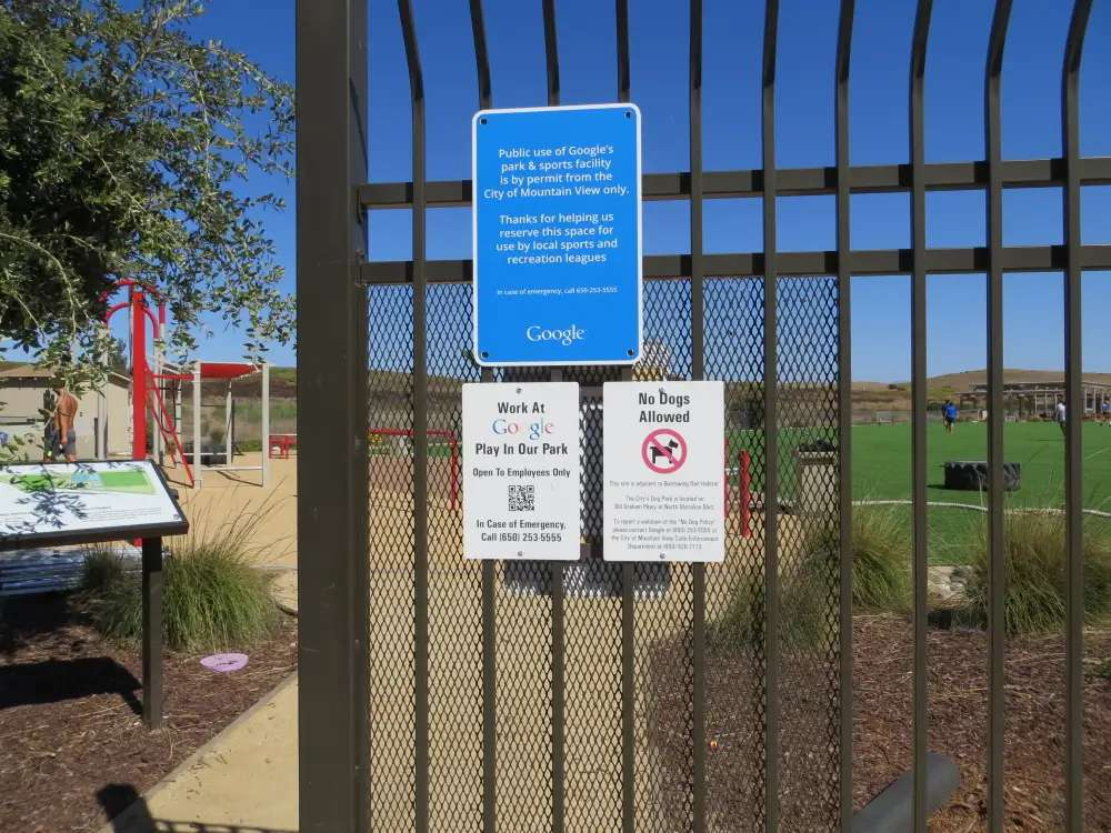 The park is next to a big swath of public lands with trails and an amphitheater, but Google's park is not open to the public. Its gates have these signs.