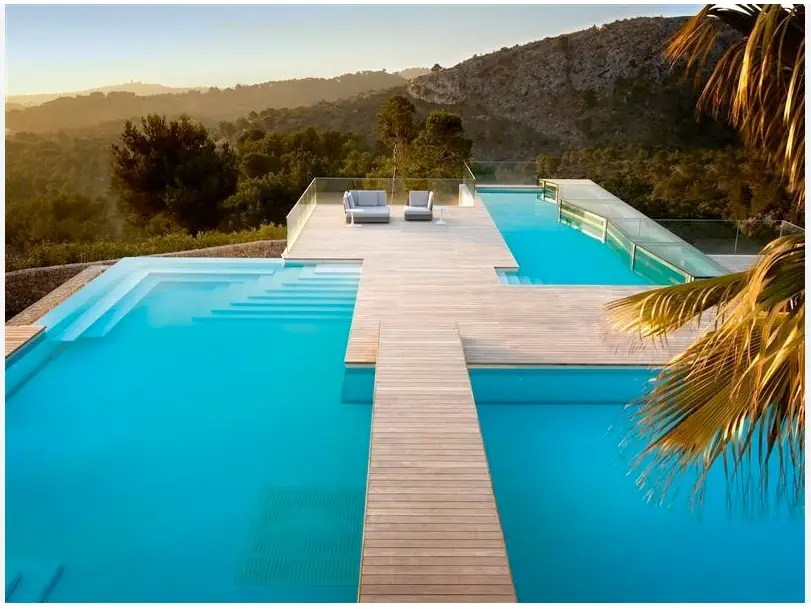 Outside, crossing the pool will bring you to a nice seating area overlooking the hills.