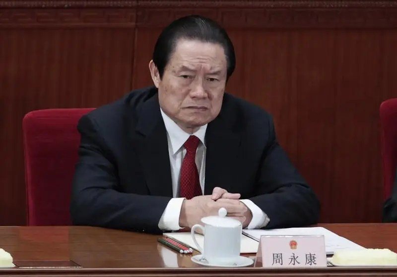 Former China's Politburo Standing Committee Member Zhou Yongkang attends the closing ceremony of the National People's Congress (NPC) at the Great Hall of the People in Beijing March 14, 2012. REUTERS/Jason Lee