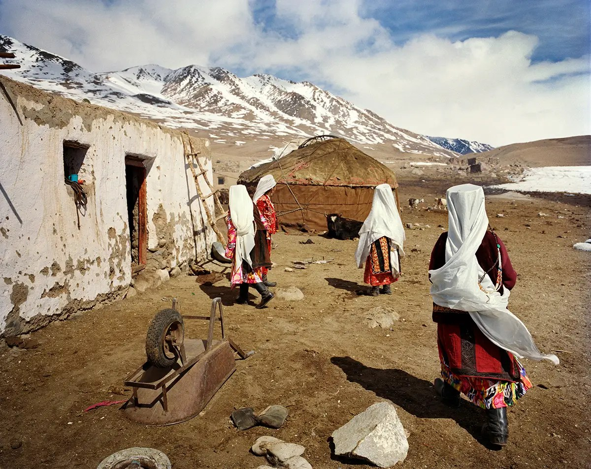 Kyrgyz and Wakhi move settlements from winter to summer. As Lagrange visited in March, these women were preparing to move to the Kyrgyz summer settlement on the other side of the lake.