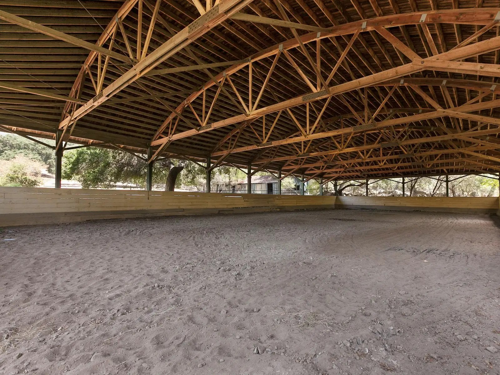 There are also outdoor paddocks, a trophy room, a covered riding arena, and an outdoor training track.