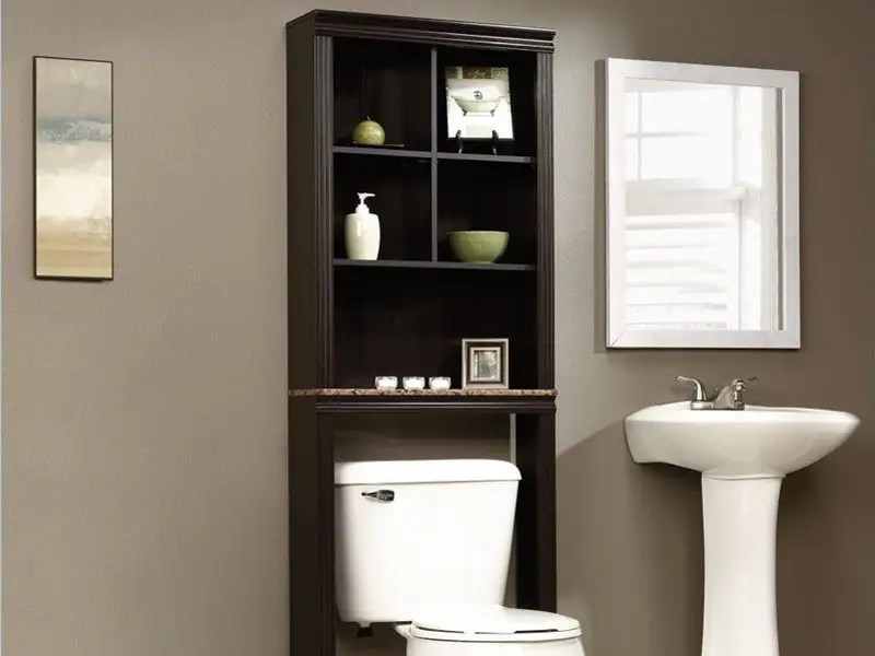 Most bathrooms are lacking in the storage department. A bathroom organizer (or étagère, if you're fancy) solves the problem while adding style. This deep cherry wood organizer is a great choice.