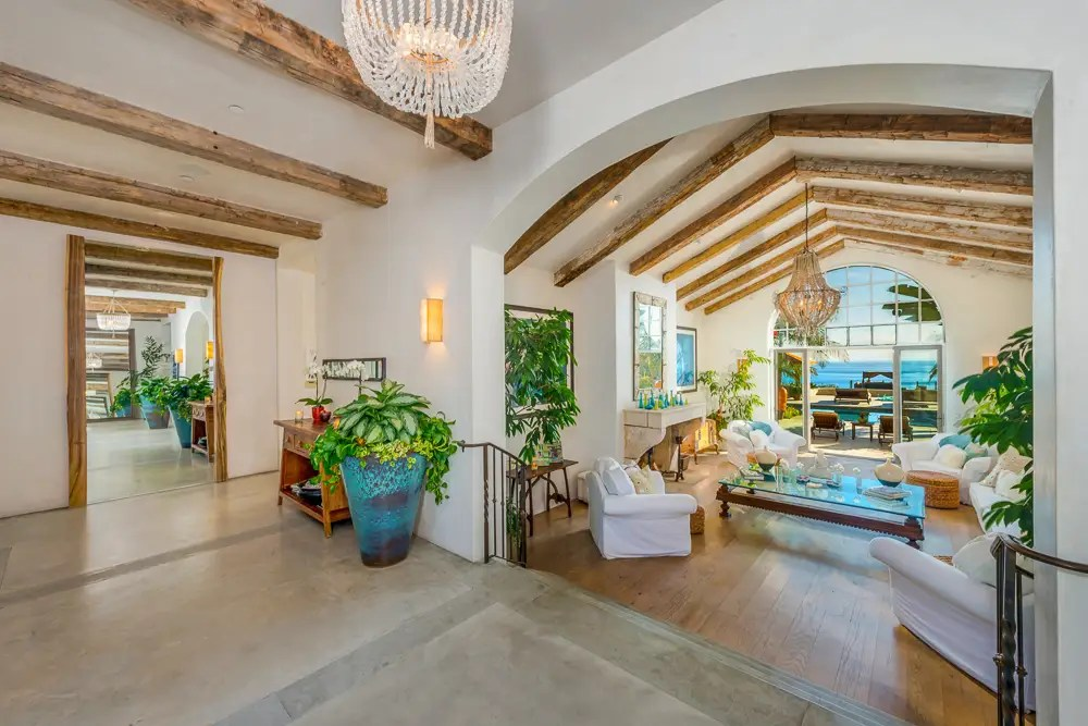 Inside, the home has beamed ceilings and 6,600 square feet of space.