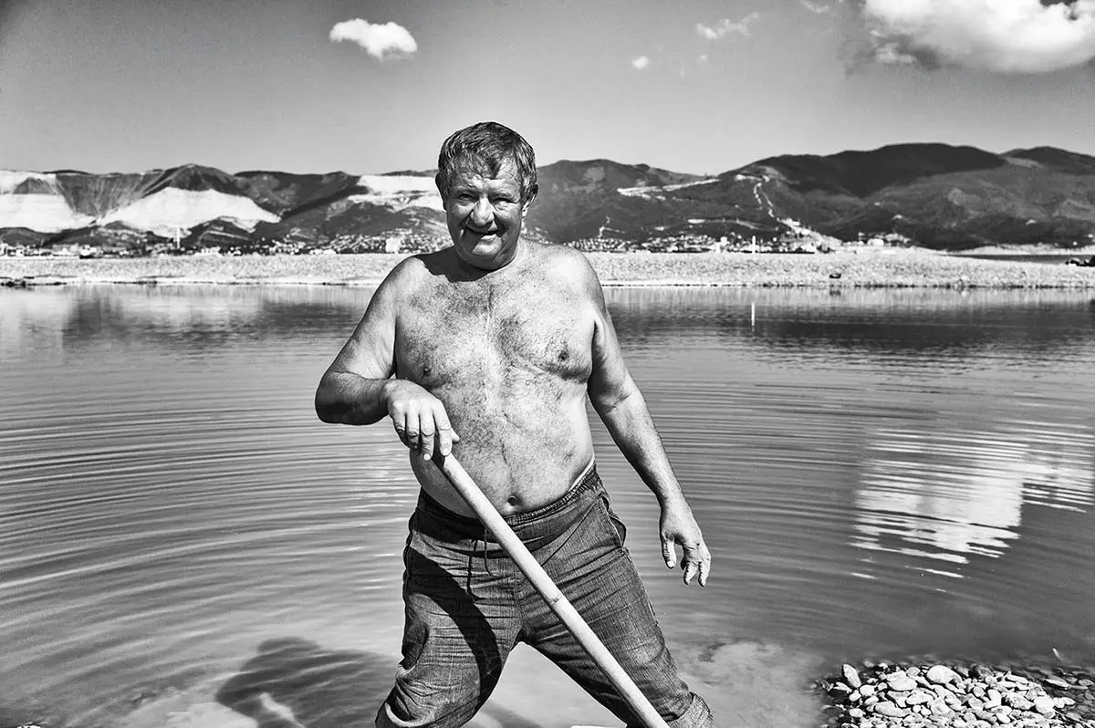 "Grigoriy, age 61. Profession: Carpenter. Passion or Dream: ""I dream of happiness for my grandchildren and I love fishing."""