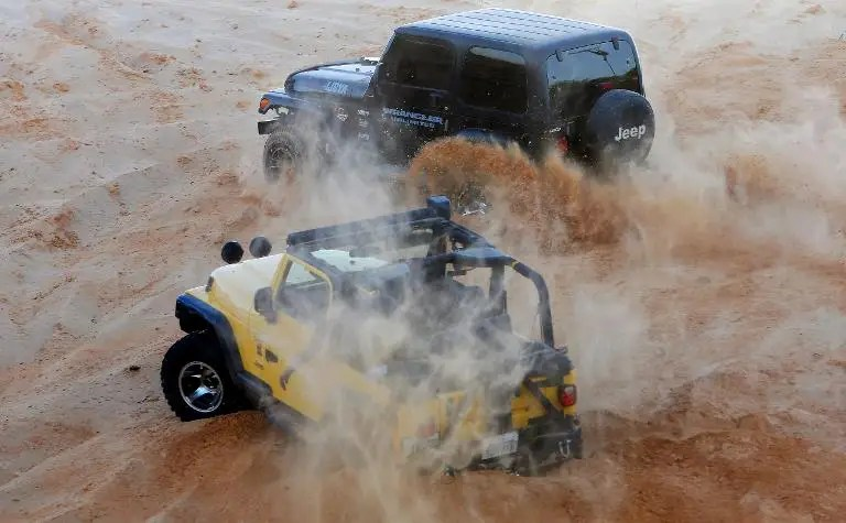 In a weekly escape from the violence gripping their country, young Libyans converge each Friday to race on the sand dunes in their four-wheel drive vehicles in Qarabuli on the Mediterranean coast, 60 kilometres east of the capital Tripoli