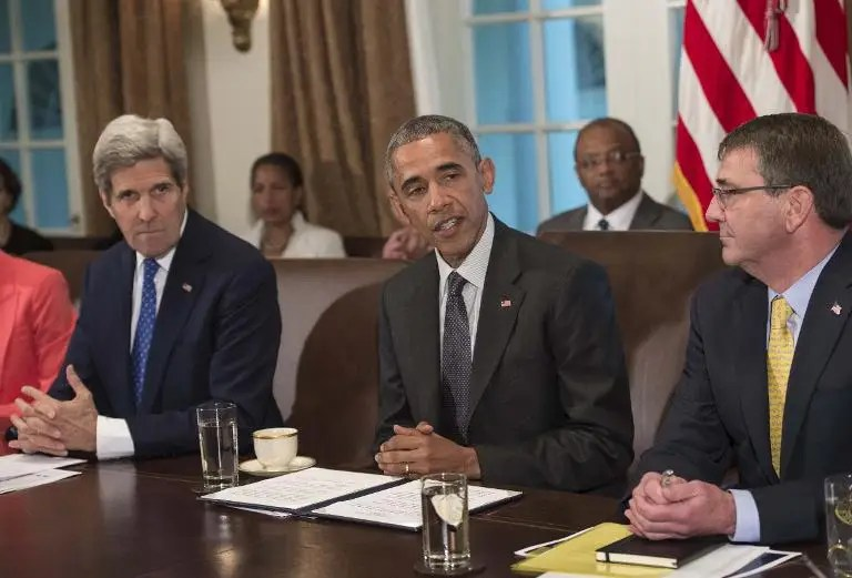 US President Barack Obama speaks during a Cabinet meeting at the White House in Washington, DC, on May 21, 2015 as Secretary of State John Kerry (L) and Defense Secretary Ashton Carter (R) look on