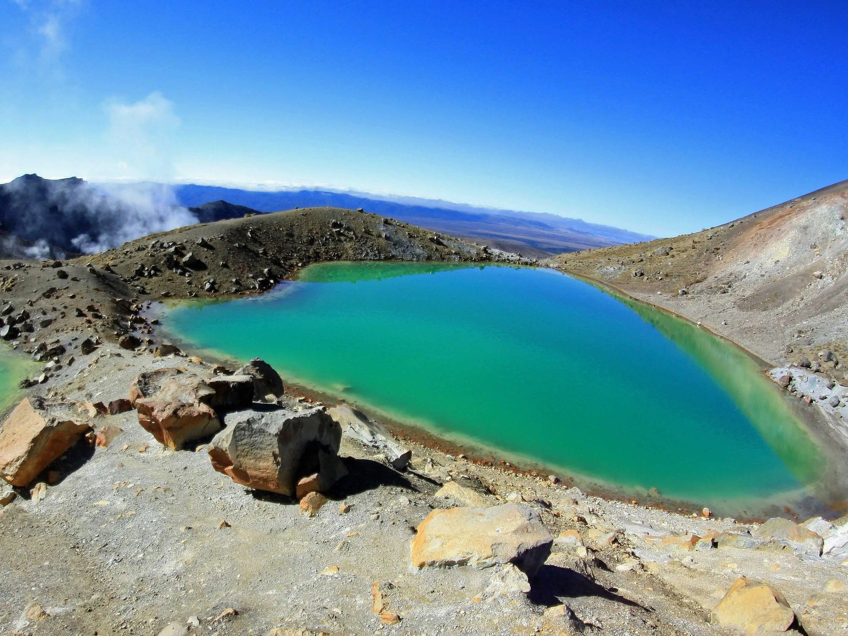 Tongariro National Park, on the North Island in New Zealand, is the oldest national park in the country and home to magnificent green lakes whose colors are the result of volcanic minerals in the water.