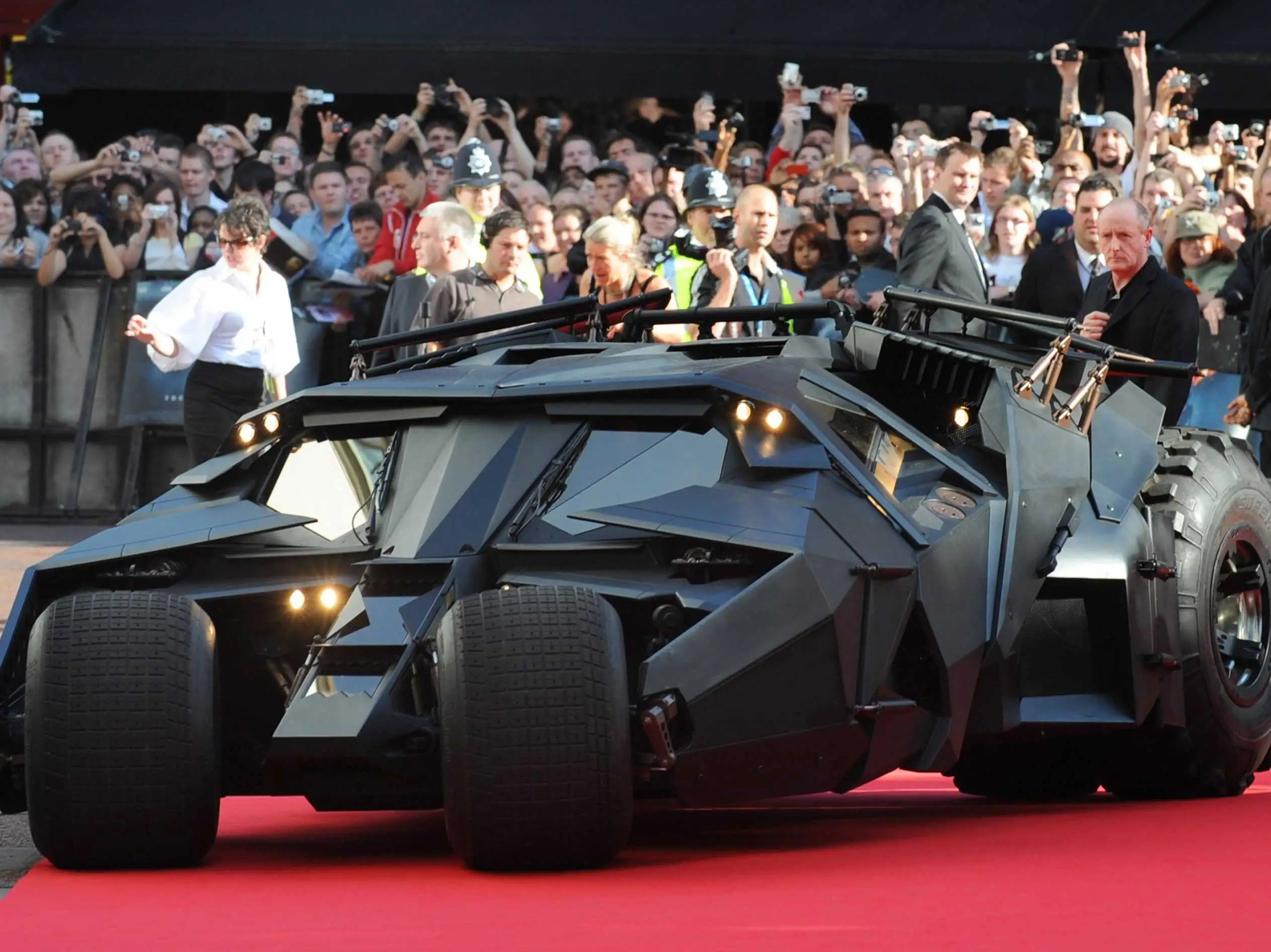 "The live-action ""Dark Knight"" trilogy from director Christopher Nolan introduced the Tumbler, an all-terrain, military-inspired version of the Batmobile. It could also be seen as a realization of the Batmobile in Miller's ""The Dark Knight Returns."""