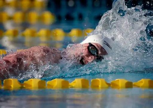 Katie Ledecky competes in the 800-meter freestyle final during the Arena Pro Swim Series swim meet, Saturday, April 16, 2016, in Mesa, Ariz. (AP Photo/Matt York)