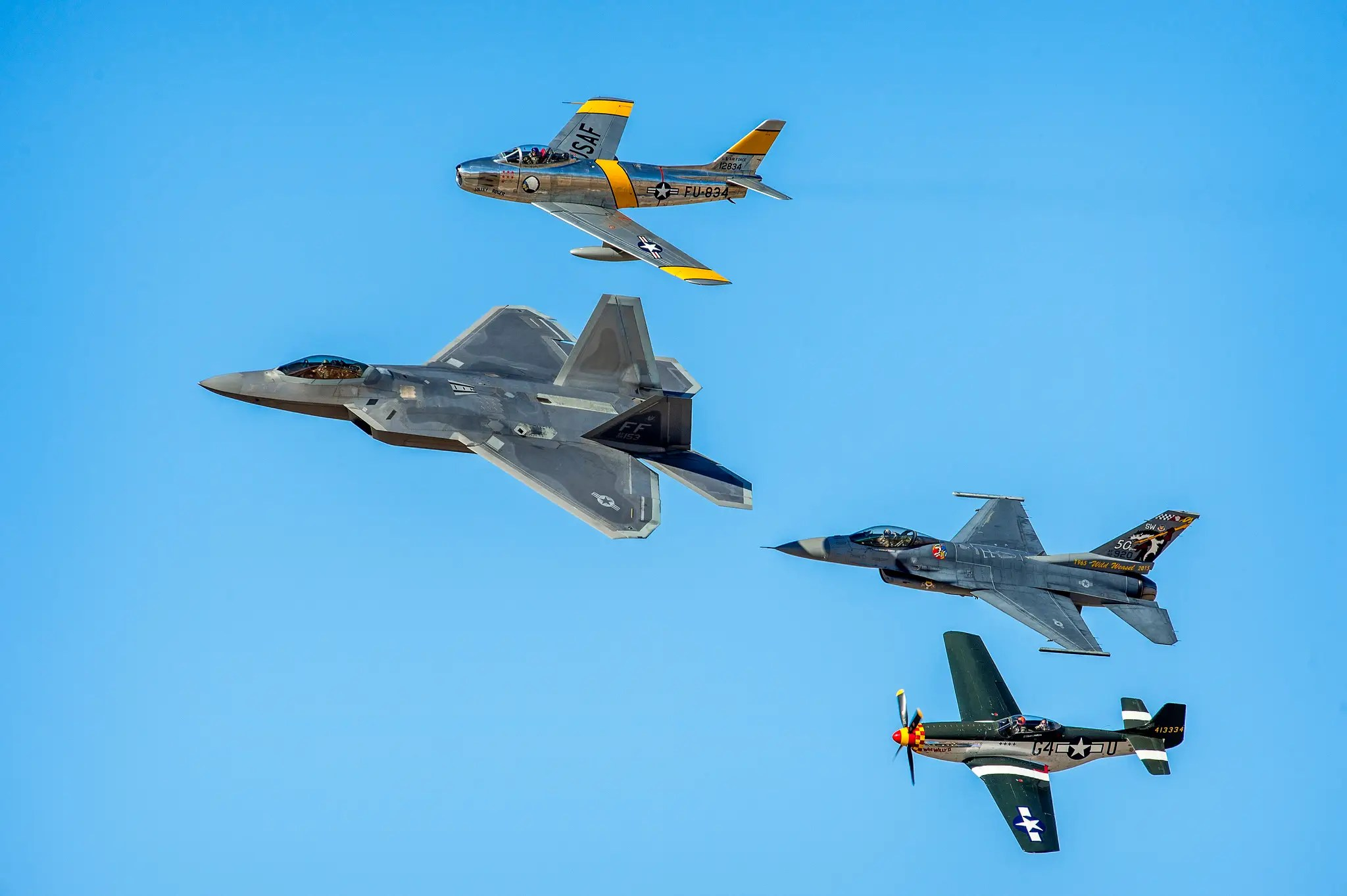 Here an F-22 Raptor leads the pack of heritage fighters, but there is an even newer aircraft at the show ...
