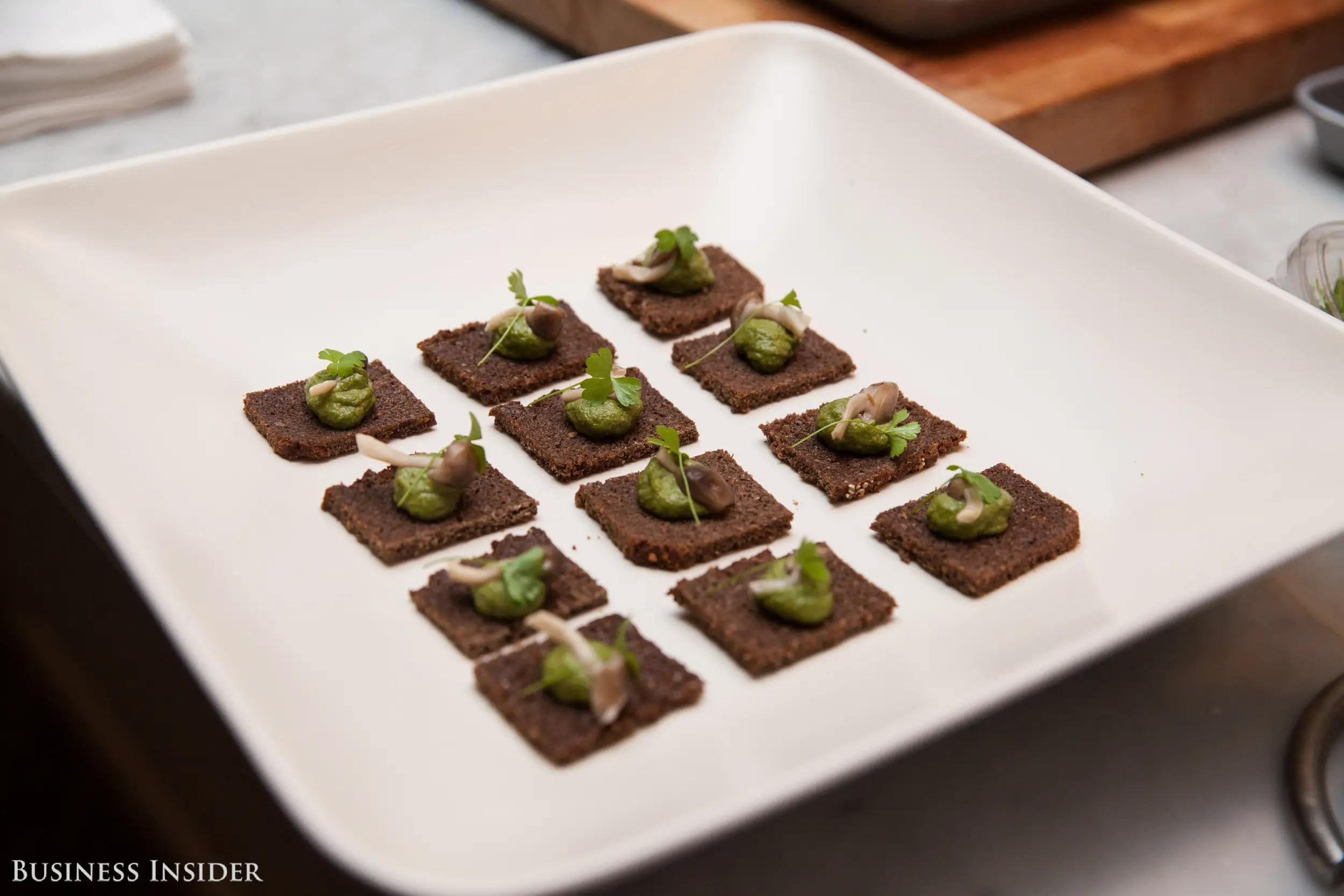 however prices range based on the menu and location pictured here is a canape made with ramp pesto and hon shimeji mushroom and served on rye toast