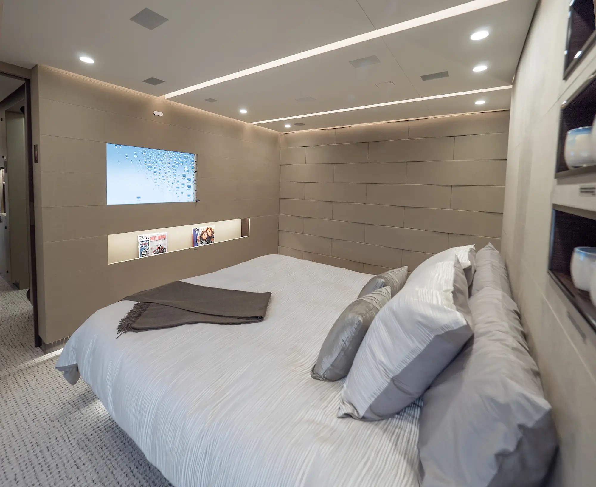 "The master suite's sleeping area features a large California king-sized bed. According to Vella, the suite is designed to be an ""oasis of silence."" In fact, the noise level in the room is during flight is just 48 decibels — on par with a quiet suburban home."