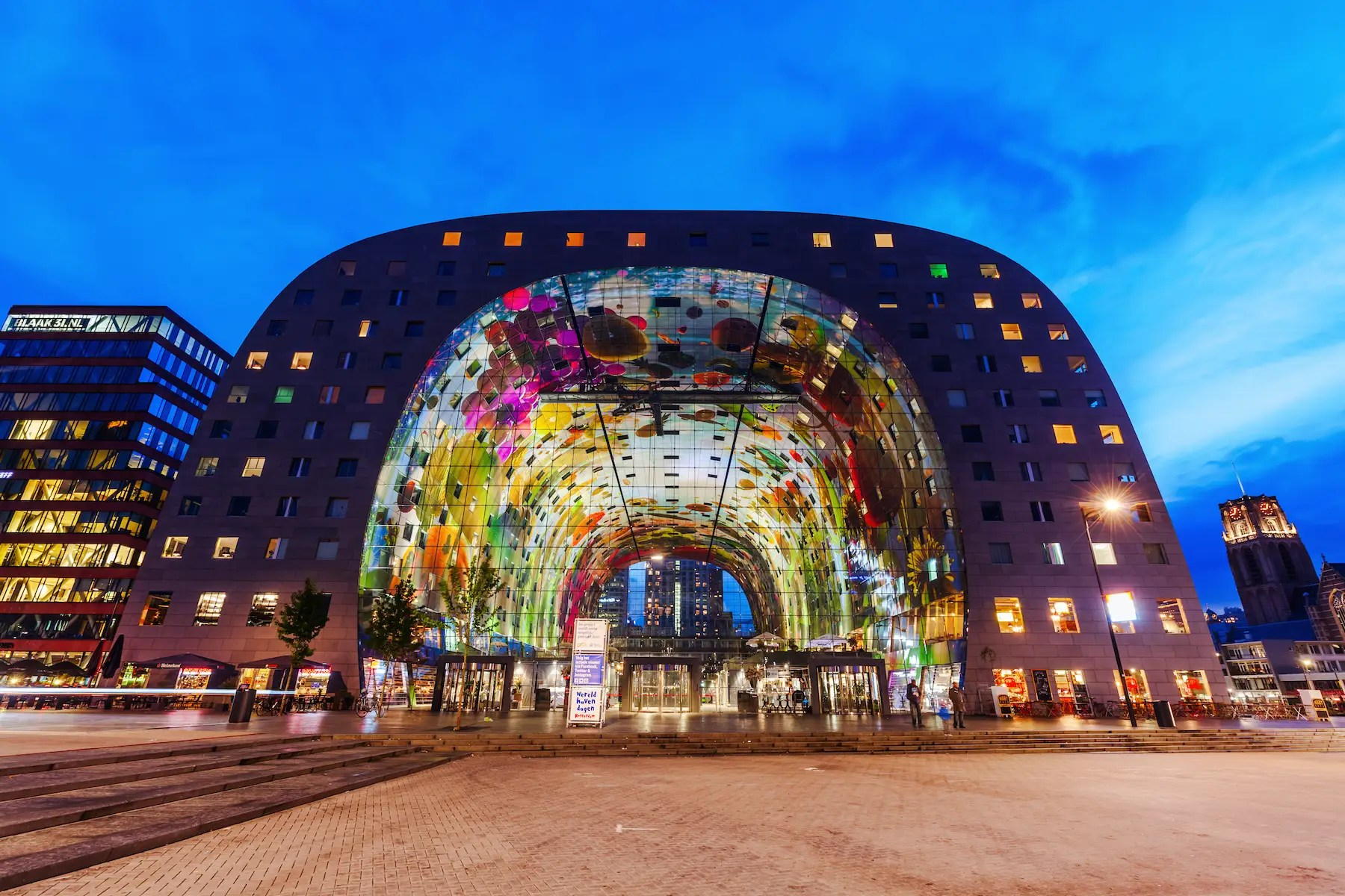 "75. The trippy Markthal in Rotterdam's Blaak market square is the work of MVRDV — the team that led the ""Superdutch"" architectural movement."