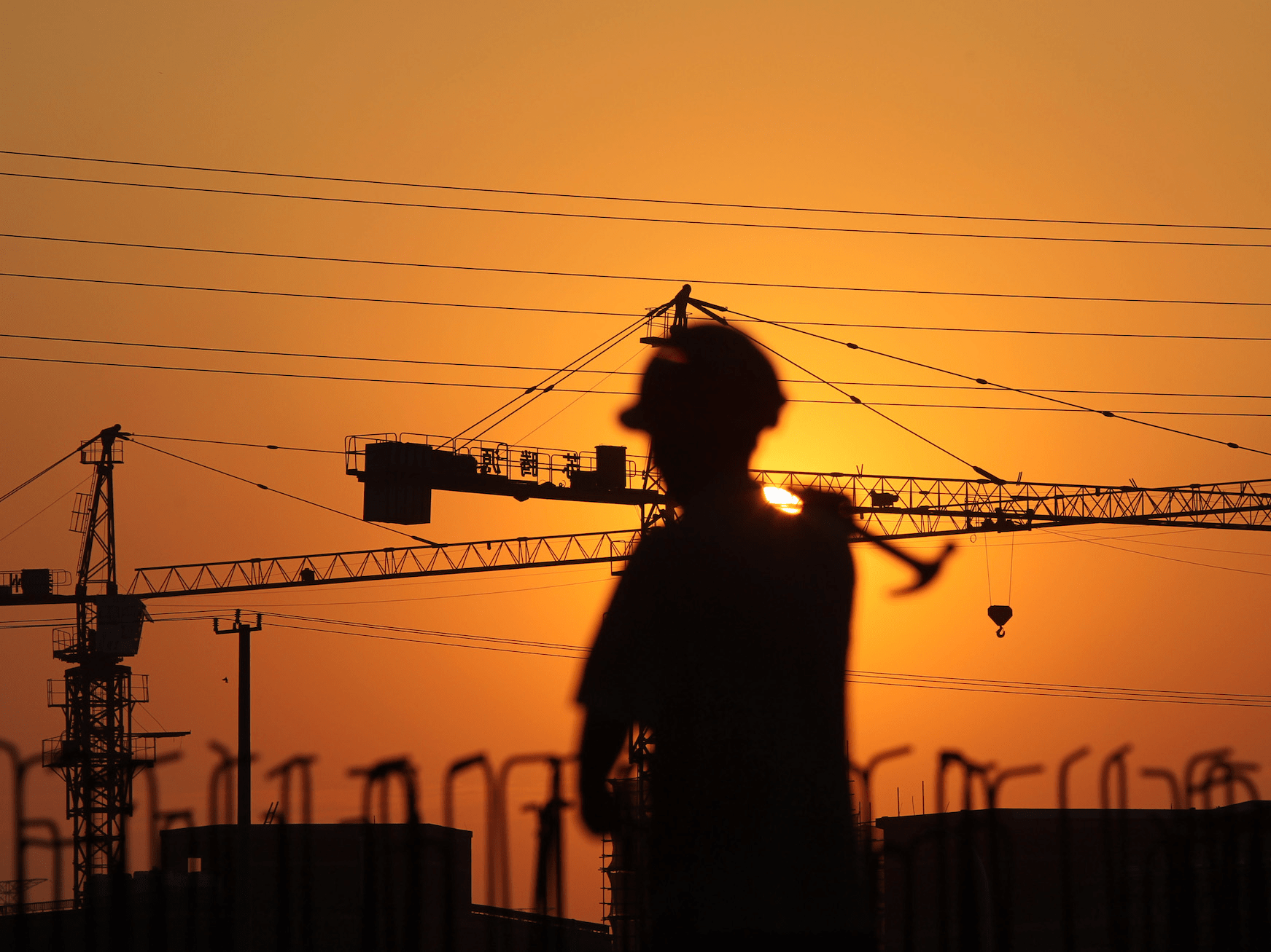 construction worker crane sunset