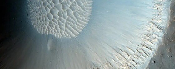 Ancient craters on Mars slowly fill up with sand dunes.