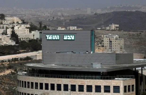 FILE PHOTO: A building belonging to Teva Pharmaceutical Industries, the world's biggest generic drugmaker and Israel's largest company, is seen in Jerusalem February 8, 2017. REUTERS/Ronen Zvulun