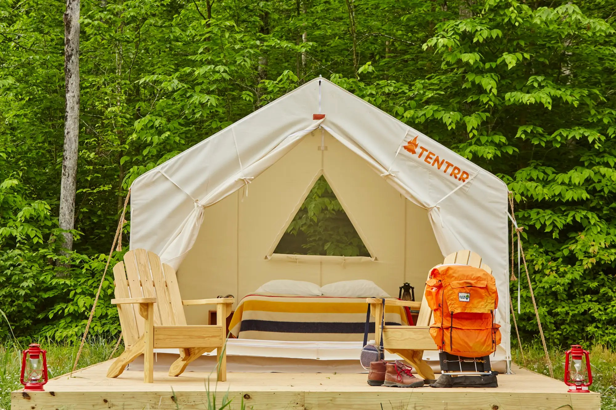 Each rental comes fully equipped with a canvas tent on a large wooded platform, a queen-sized air mattress, two Adirondack chairs, a fire pit, cookware, and a portable toilet.