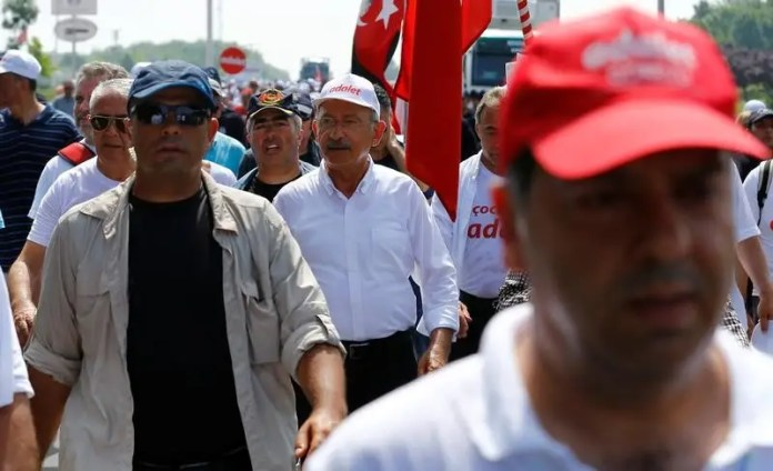Turkey's main opposition Republican People's Party (CHP) leader Kemal Kilicdaroglu walks during the 19th day of a protest, dubbed