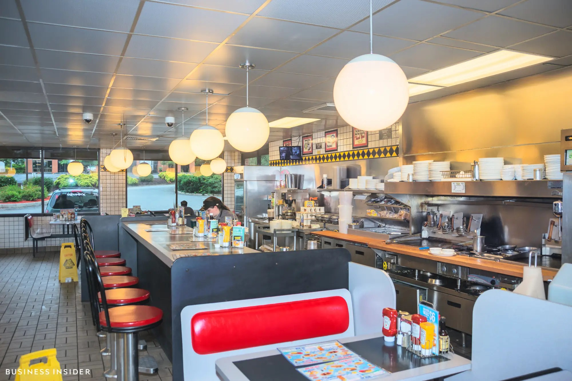 We could hear the food sizzling on the griddle as we cozied into our booth. We could have even hopped the side and poured the waffle batter ourselves — our waitress didn't have to leave the kitchen to take our order and deliver it steaming hot.