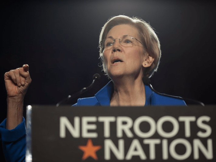 FILE PHOTO: Senator Elizabeth Warren (D-MA) addresses the audience at the morning plenary session at the Netroots Nation conference for political progressives in Atlanta, Georgia, U.S. August 12, 2017. REUTERS/Christopher Aluka Berry