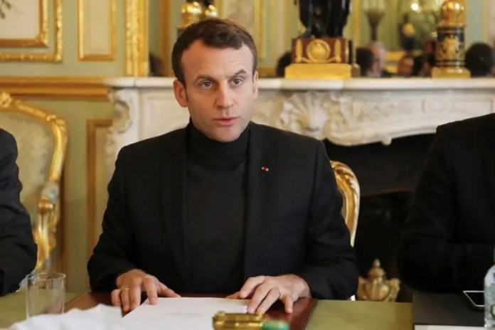 FILE PHOTO: French President Emmanuel Macron speaks during a Trianon Council meeting (Conseil de coordination du dialogue de Trianon) aiming to strenghten the links between France and Russia at the Elysee Palace in Paris, France, Febuary 9, 2018.     REUTERS/Ludovic Marin/Pool