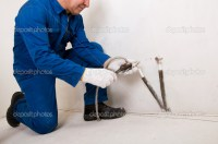 Plumber fixing water pipe  Stock Photo  dimmushka #3740382