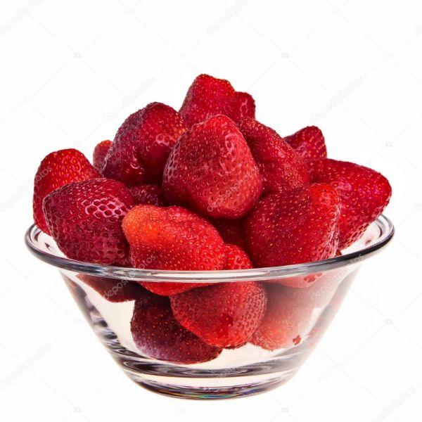 Fresh tasty strawberries in glass bowl Stock Photo