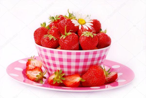 Fresh strawberries in bowl Stock Photo teresaterra