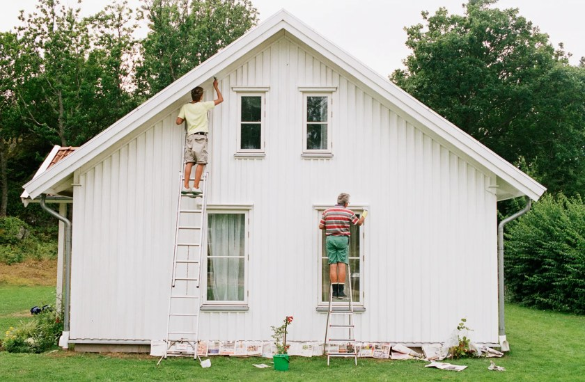 Men painting a house home repairs paint