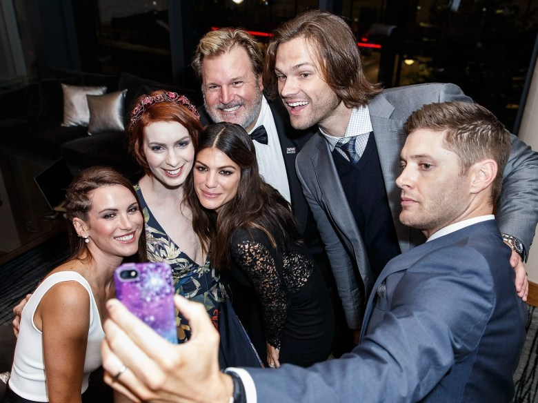 Actress Danneel Ackles, Actress Felicia Day, Actress Genevieve Padalecki, Producer Jim Michaels, Actor Jared Padalecki and Actor Jensen Ackles take a selfie at the 200th episode of 'Supernatural' party at Fairmont Pacific Rim Hotel on October 18, 2014 in Vancouver, Canada.