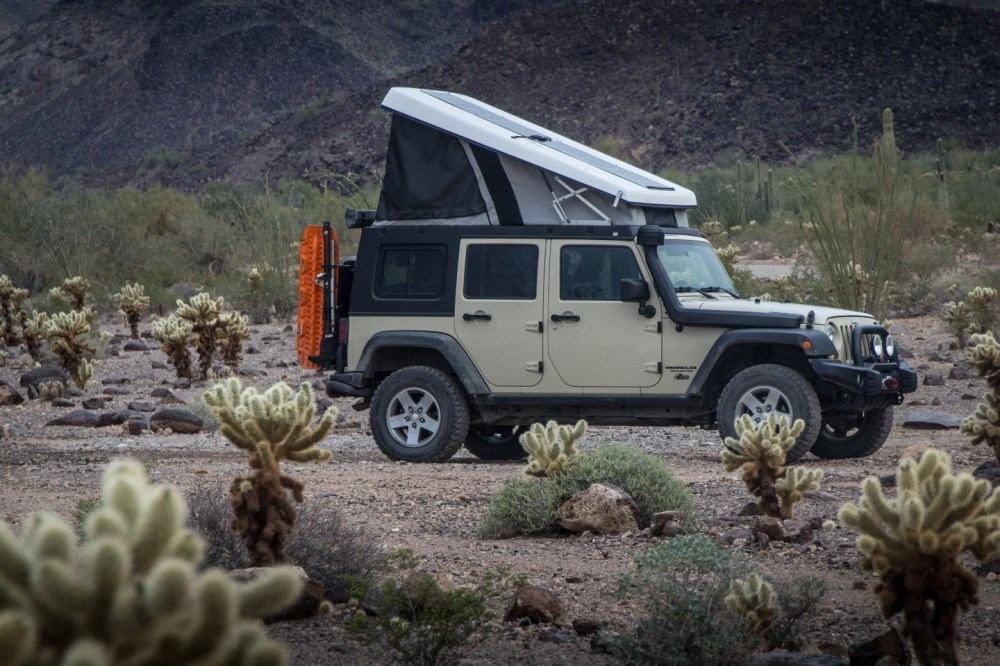 medium resolution of the jeep with popup j30 camper
