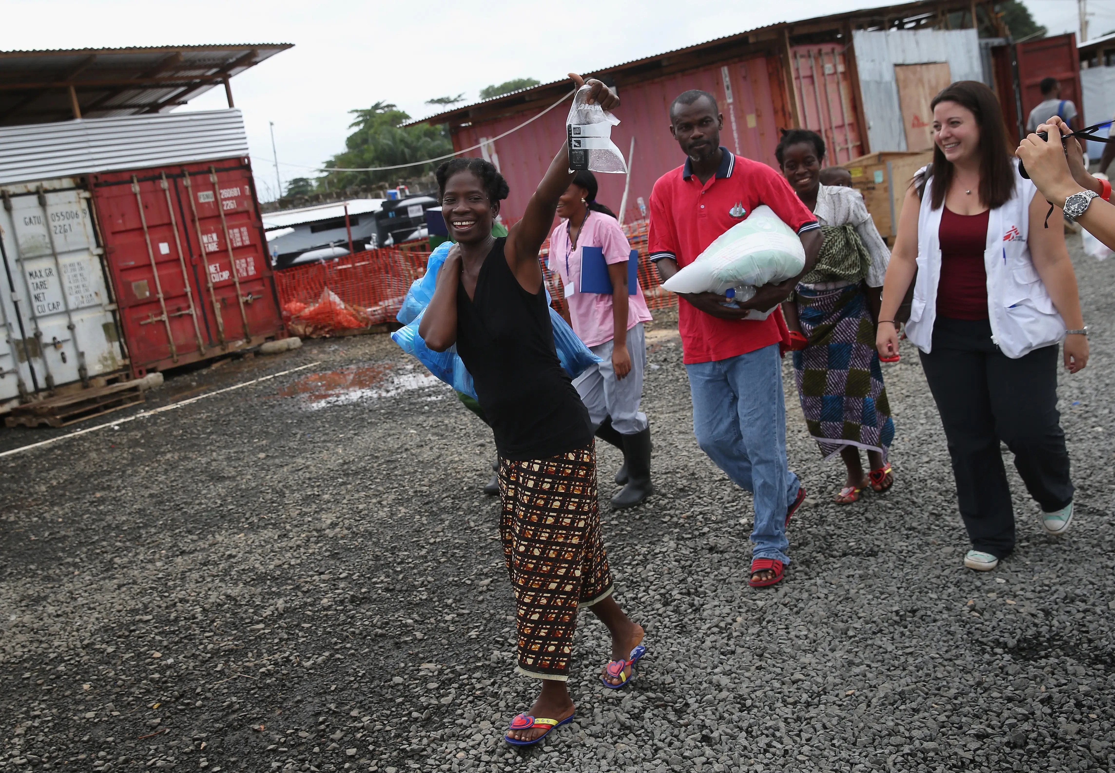 The devastating Ebola outbreak this year was the largest outbreak of the frightening virus in history. In this photo from October, survivor Sontay Massaley, 37, leaves an MSF clinic in Paynesville, Liberia. She is returning to her three healthy children after spending eight days in treatment.