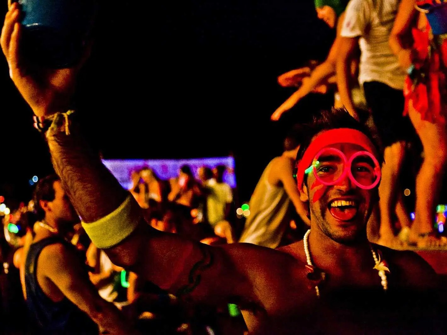 Dance the night away decked out in neon at one of the monthly full moon parties in Koh Phangan, Thailand. The beach rave starts at dusk and continues till the early hours of the morning.