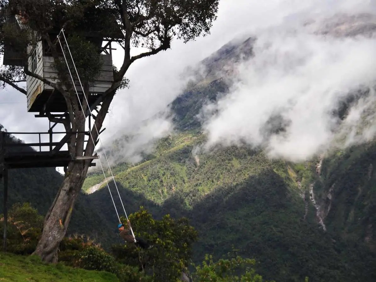 Swing on the Swing at the End of the World at the Casa de Arbol in Ecuador and glimpse stunning views of the Tungurahua Volcano.