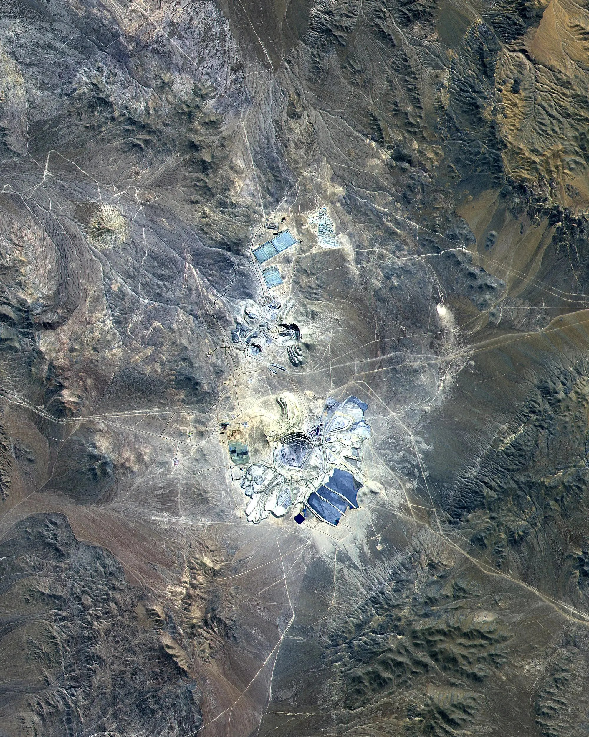 The Escondida mine in Chile's Atacama Desert has transformed the landscape to extract precious metals like gold, silver, and copper.