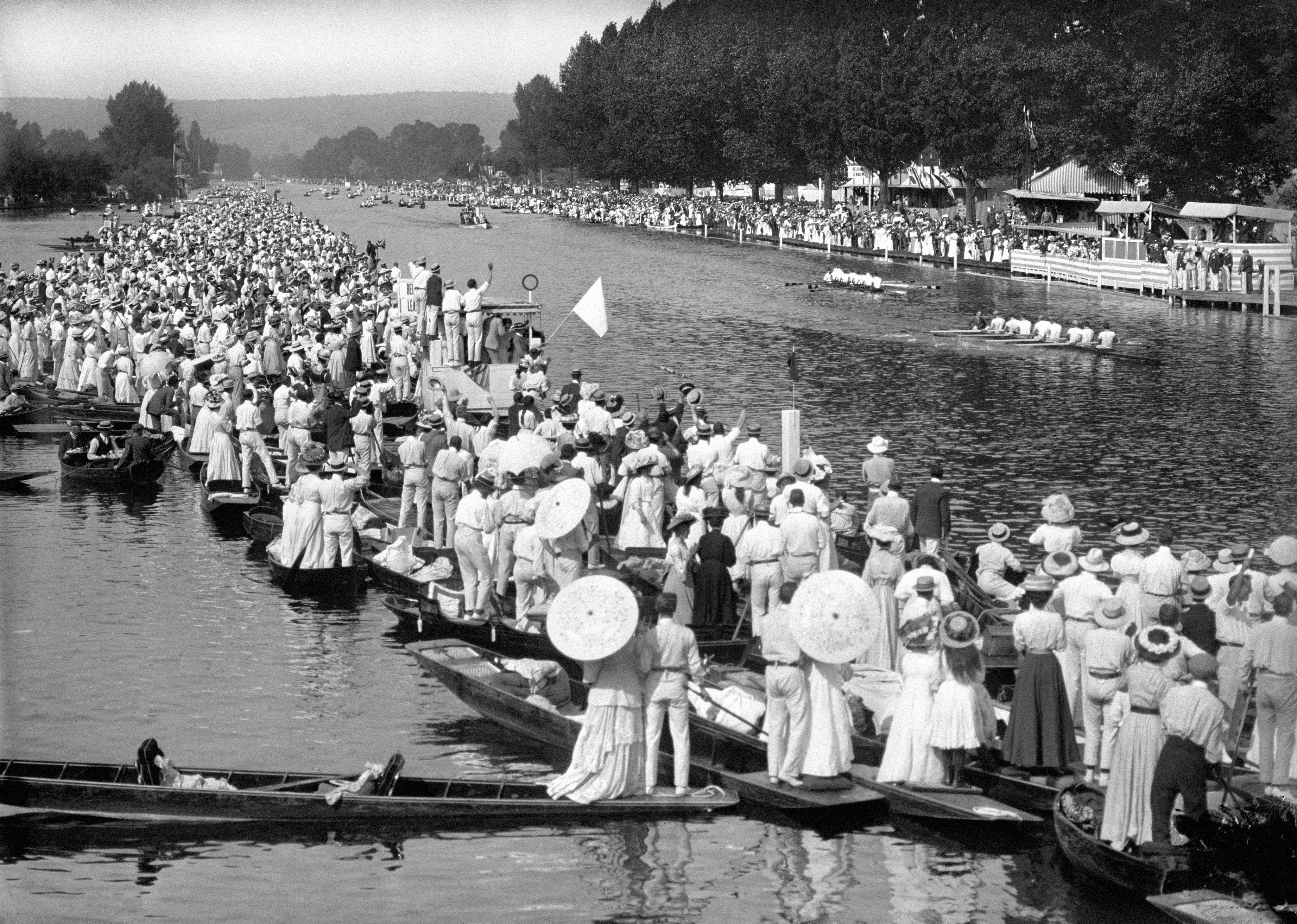 London, 1908: The eruption of Mount Vesuvius in 1906 meant the games were relocated from Rome to London on financial grounds. This image shows spectators gathering as Great Britain, represented by the Leander club, beats Belgium to win gold in the rowing.