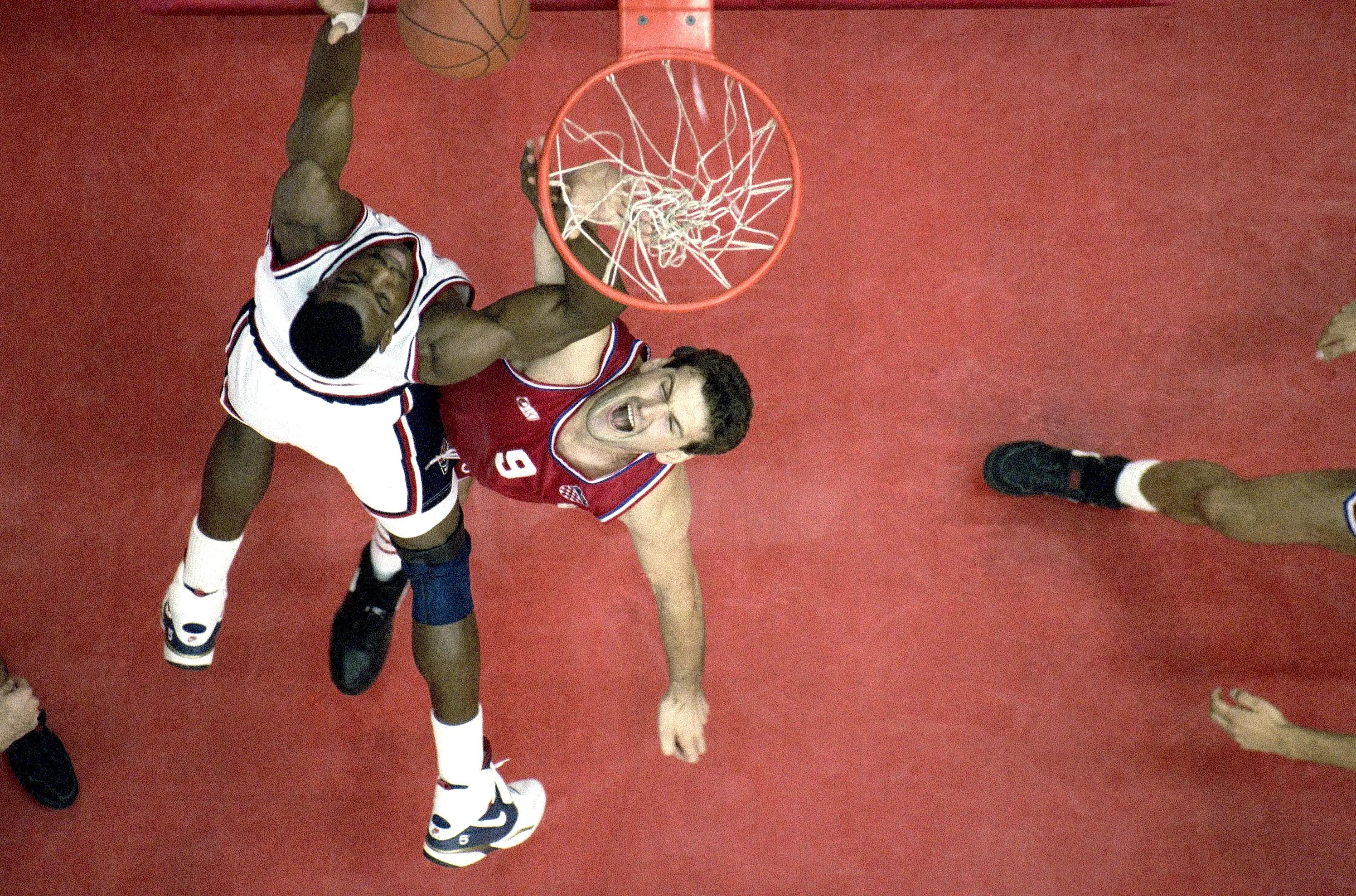 "Barcelona, 1992: The USA's David Robinson crushed Croatia's Franjo Arapovic on his way to the hoop during his team's gold medal game. This was the first time NBA professionals — including Michael Jordan — had been chosen to play in the Olympics. They were called the ""Dream Team"" and sailed through to finals."